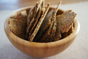 Healthy crackers in a wooden bowl