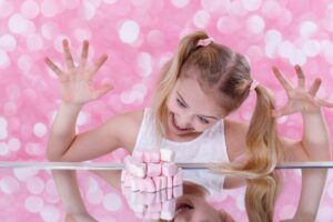 Young girl very excited to eat her candy