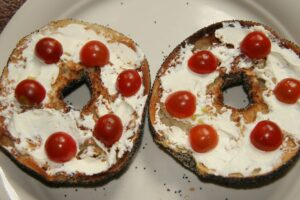 bagels with cream cheese and baby tomatoes