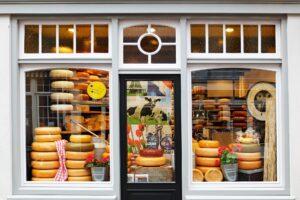cheese shop window full of huge amounts of cheese