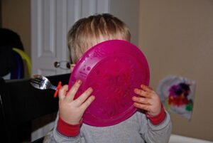 child licking dinner plate clean