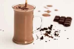 chocolate milk with straw and chocolate bar