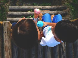 two small kids eating ice cream in the playground