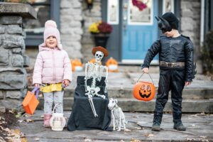 two young children out Halloween candy collecting