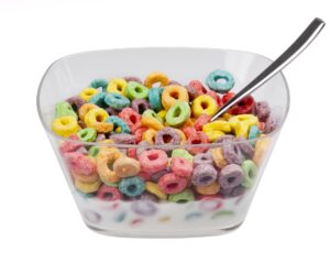 Bowl of Froot Loops an milk with a spoon