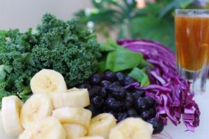 Kale, plantain, spinach, red cabbage and berries