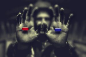 Man holding out a red and a blue pill representing control and choice