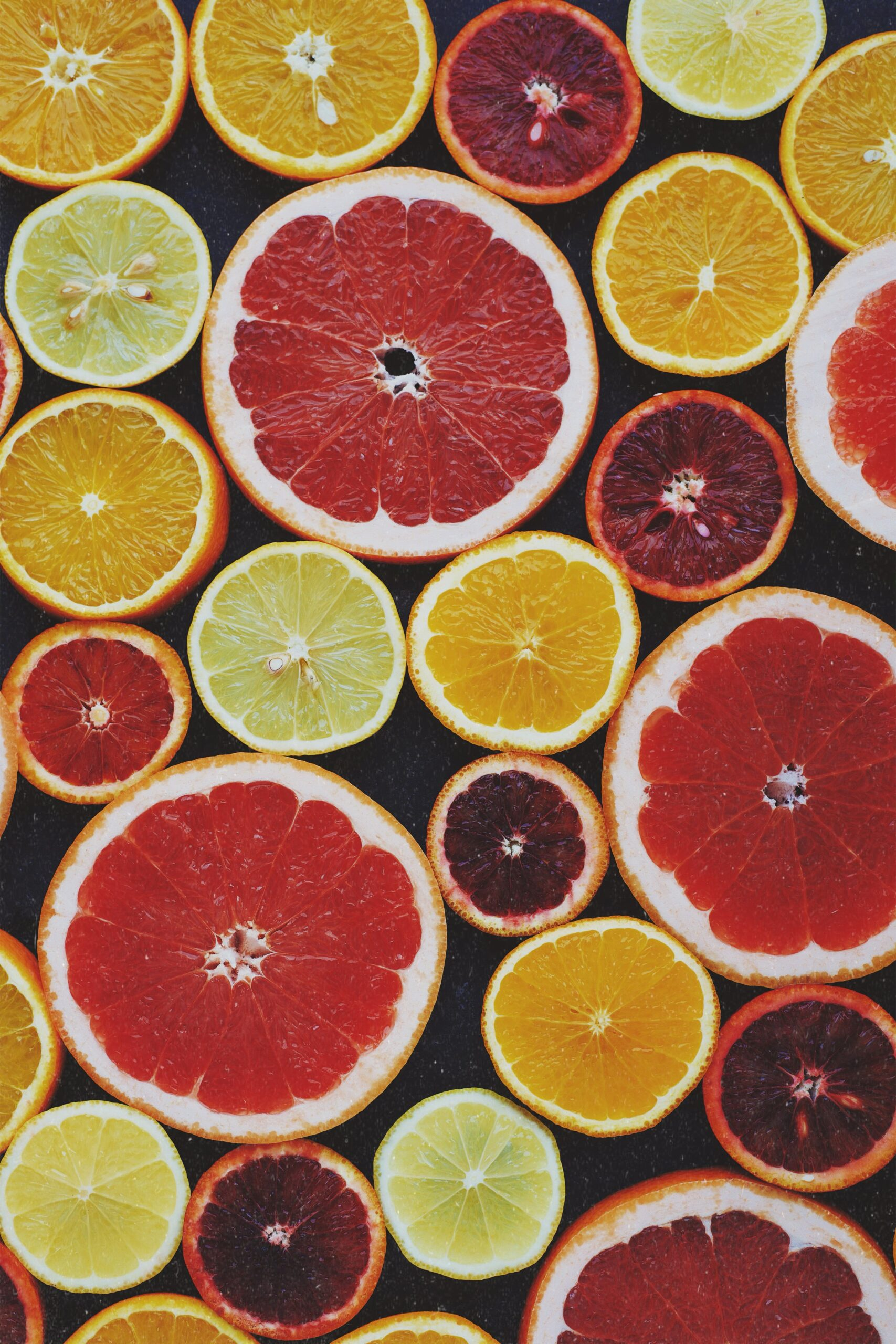 Many Citrus fruits cut in halves for juicing