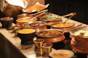 Pots of different Indian curries and rice