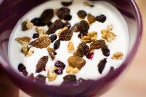 bowl of yoghurt with raisins and nuts