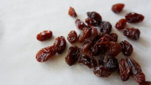 handful of raisins on a counter