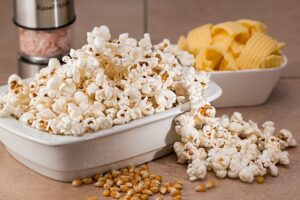 sweet and salty popcorn and crisps in bowls