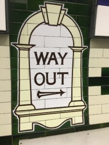 way out sign on tiles